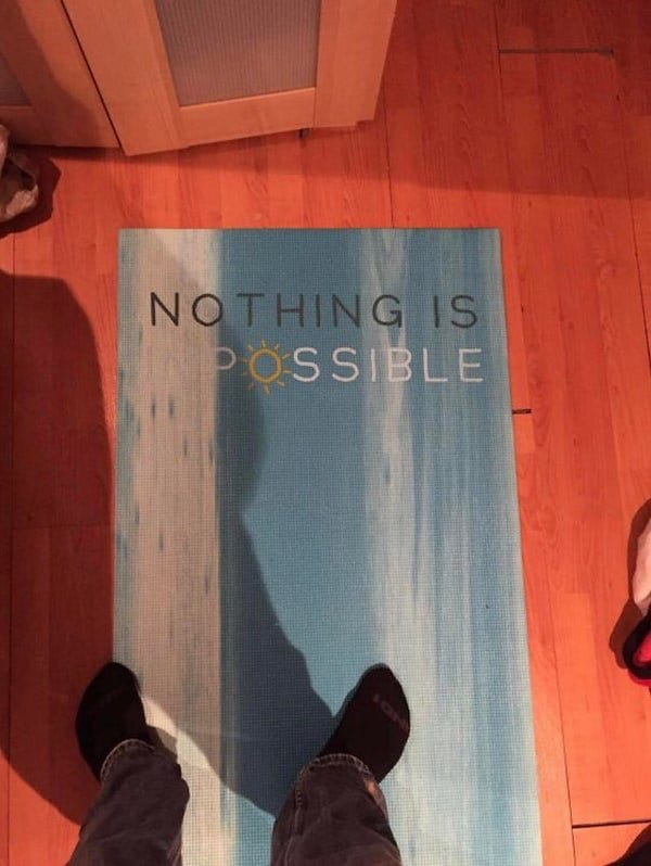 Sign is meant to say 'Nothing is impossible' but the 'im' is written in white on a white background, so it appears to say 'Nothing is possible.'
