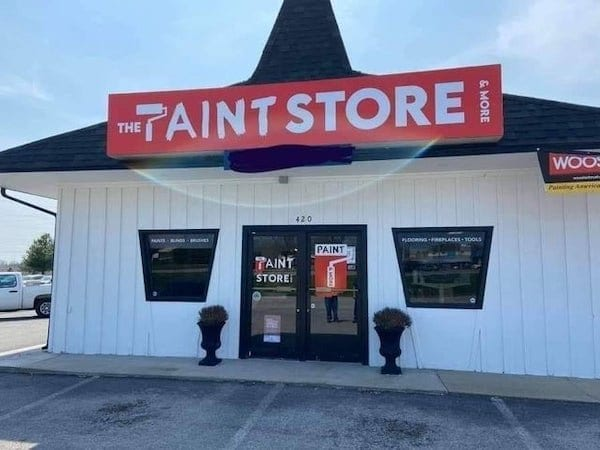 Paint store sign uses a paint roller in place of the P and from a distance it looks like an inappropriate word instead of paint.
